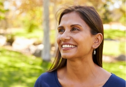 Hispanic woman smiling standing outdoors