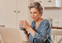 Woman drinking coffee viewing computer screen